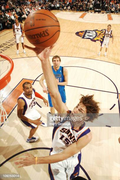 Robin Lopez of the Phoenix Suns grabs a rebound against the Dallas Mavericks in an NBA game played on February 17 2011 at US Airways Center in...