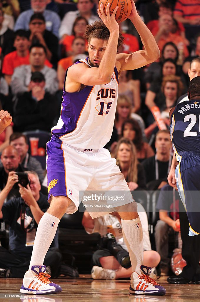 <a gi-track='captionPersonalityLinkClicked' href=/galleries/search?phrase=Robin+Lopez&family=editorial&specificpeople=2351509 ng-click='$event.stopPropagation()'>Robin Lopez</a> #15 of the Phoenix Suns looks to make a play against the Memphis Grizzlies in an NBA game played on March 10, 2012 at U.S. Airways Center in Phoenix, Arizona.