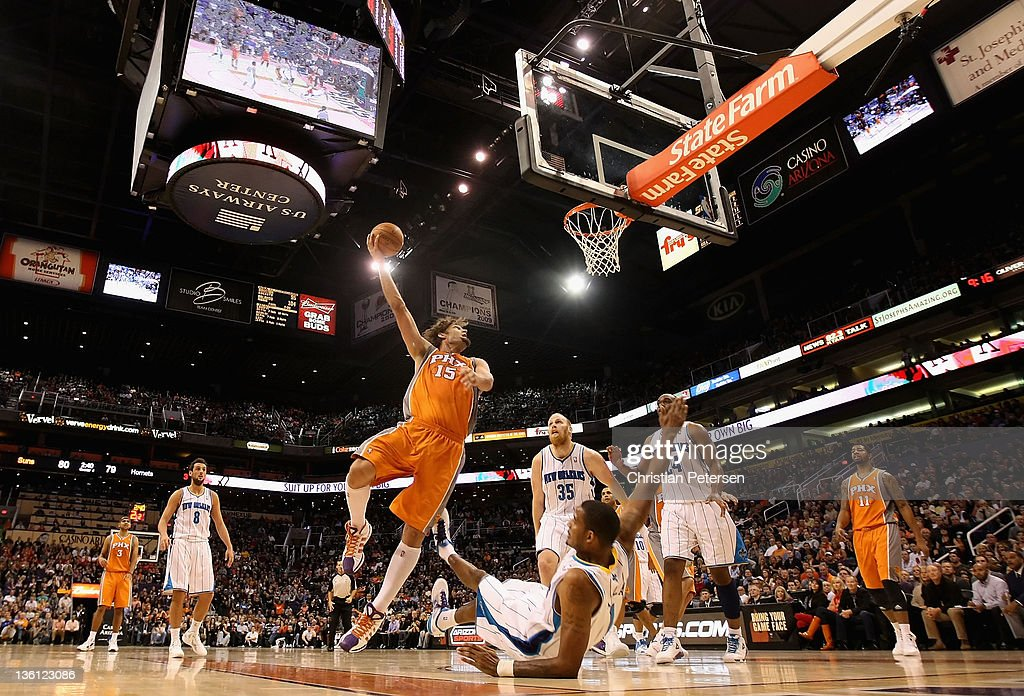 Robin Lopez of the Phoenix Suns puts up a shot against the New Orleans Hornets during the season openning NBA game at US Airways Center on December...