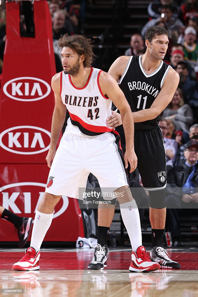 Robin Lopez of the Portland Trail Blazers and Brook Lopez of the Brooklyn Nets during the game on November 15 2014 at the Moda Center Arena in...