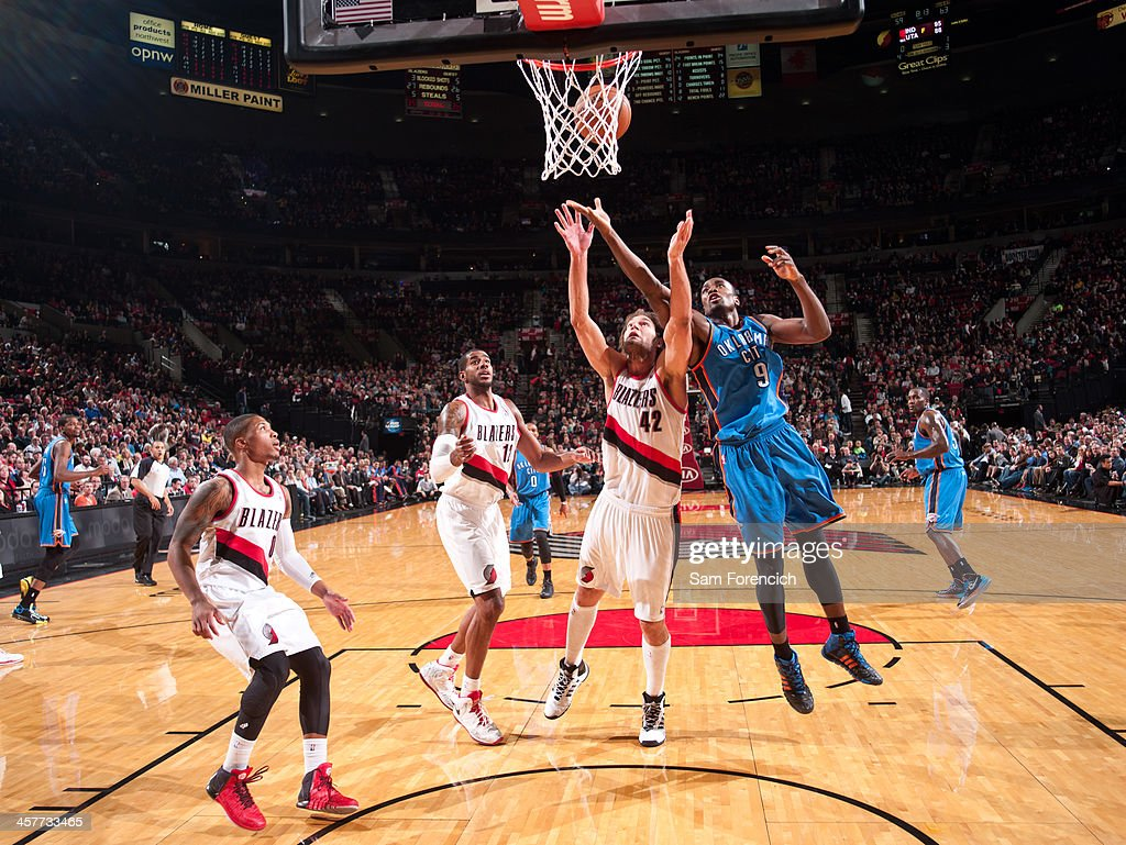 <a gi-track='captionPersonalityLinkClicked' href=/galleries/search?phrase=Robin+Lopez&family=editorial&specificpeople=2351509 ng-click='$event.stopPropagation()'>Robin Lopez</a> #42 of the Portland Trail Blazers and <a gi-track='captionPersonalityLinkClicked' href=/galleries/search?phrase=Serge+Ibaka&family=editorial&specificpeople=5133378 ng-click='$event.stopPropagation()'>Serge Ibaka</a> #9 of the Oklahoma City Thunder go up for a rebound on December 4, 2013 at the Moda Center Arena in Portland, Oregon.