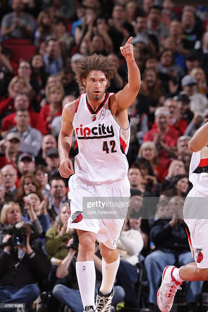 <a gi-track='captionPersonalityLinkClicked' href=/galleries/search?phrase=Robin+Lopez&family=editorial&specificpeople=2351509 ng-click='$event.stopPropagation()'>Robin Lopez</a> #42 of the Portland Trail Blazers celebrates against the Brooklyn Nets on February 26, 2014 at the Moda Center Arena in Portland, Oregon.