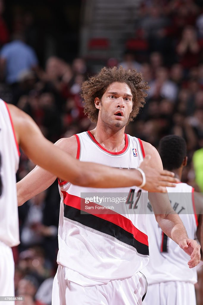 <a gi-track='captionPersonalityLinkClicked' href=/galleries/search?phrase=Robin+Lopez&family=editorial&specificpeople=2351509 ng-click='$event.stopPropagation()'>Robin Lopez</a> #42 of the Portland Trail Blazers celebrates against the Milwaukee Bucks on March 18, 2014 at the Moda Center Arena in Portland, Oregon.