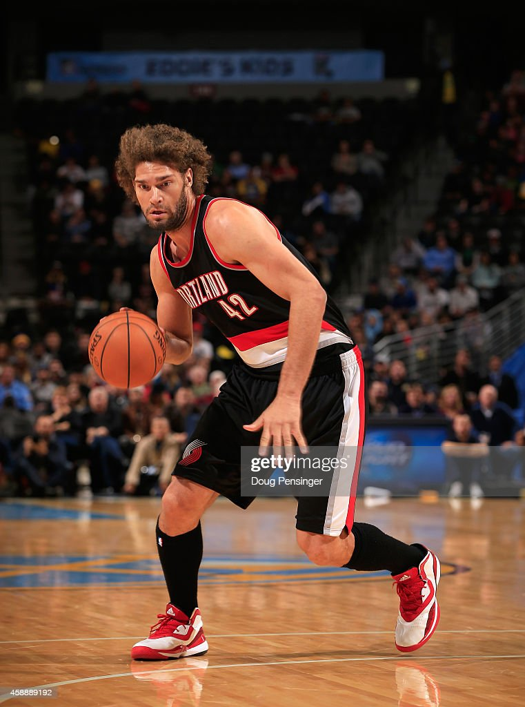 Robin Lopez of the Portland Trail Blazers controls the ball against the Denver Nuggets at Pepsi Center on November 12 2014 in Denver Colorado The...