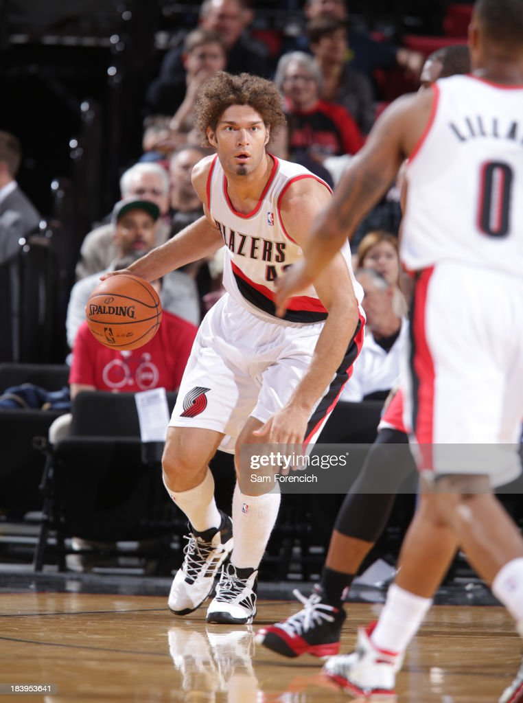 <a gi-track='captionPersonalityLinkClicked' href=/galleries/search?phrase=Robin+Lopez&family=editorial&specificpeople=2351509 ng-click='$event.stopPropagation()'>Robin Lopez</a> #42 of the Portland Trail Blazers dribbles the ball against the Los Angeles Clippers on October 7, 2013 at the Moda Center Arena in Portland, Oregon.