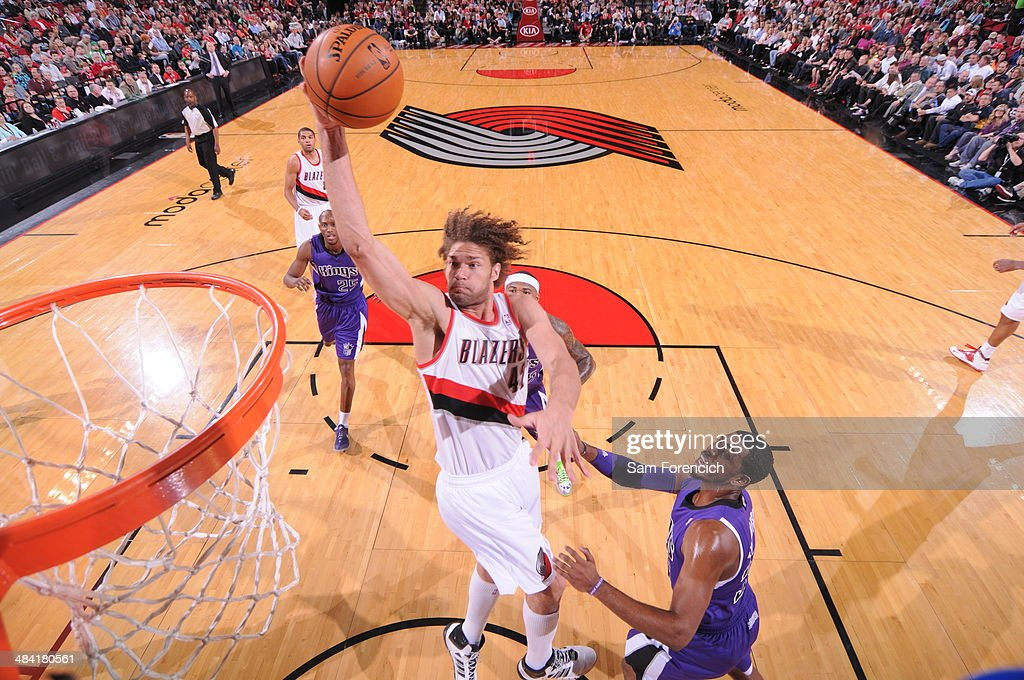 <a gi-track='captionPersonalityLinkClicked' href=/galleries/search?phrase=Robin+Lopez&family=editorial&specificpeople=2351509 ng-click='$event.stopPropagation()'>Robin Lopez</a> #42 of the Portland Trail Blazers drives to the basket against the Sacramento Kings on April 9, 2014 at the Moda Center Arena in Portland, Oregon.