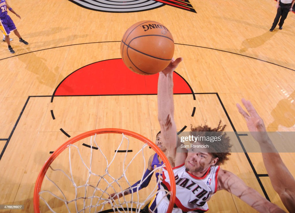 <a gi-track='captionPersonalityLinkClicked' href=/galleries/search?phrase=Robin+Lopez&family=editorial&specificpeople=2351509 ng-click='$event.stopPropagation()'>Robin Lopez</a> #42 of the Portland Trail Blazers dunks the ball against the Los Angeles Lakers on March 3, 2014 at the Moda Center Arena in Portland, Oregon.