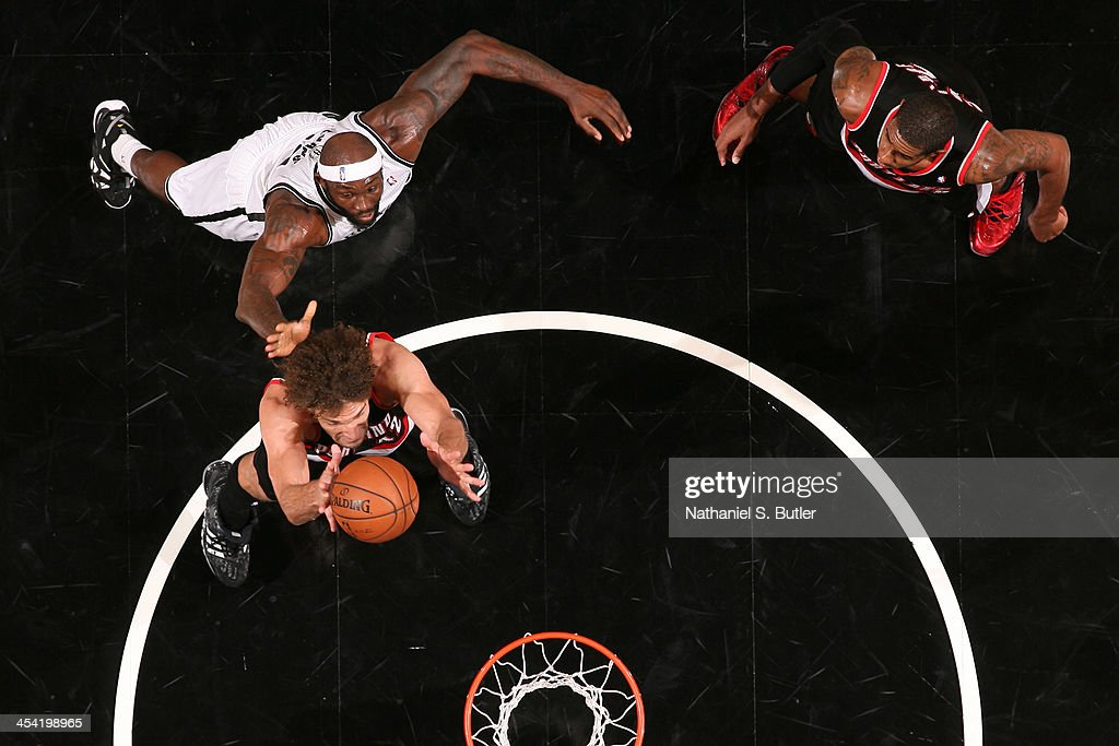 <a gi-track='captionPersonalityLinkClicked' href=/galleries/search?phrase=Robin+Lopez&family=editorial&specificpeople=2351509 ng-click='$event.stopPropagation()'>Robin Lopez</a> #42 of the Portland Trail Blazers grabs a rebound against the Brooklyn Nets at Barclays Center on November 18, 2013 in the Brooklyn borough of New York City.