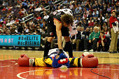Robin Lopez of the Portland Trail Blazers jokes with the Washington Wizards mascot during a timeout in the first half at Verizon Center on March 16...
