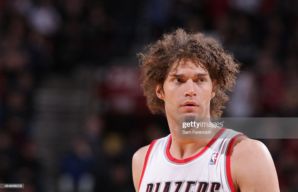 <a gi-track='captionPersonalityLinkClicked' href=/galleries/search?phrase=Robin+Lopez&family=editorial&specificpeople=2351509 ng-click='$event.stopPropagation()'>Robin Lopez</a> #42 of the Portland Trail Blazers looks on during the game against the Denver Nuggets on January 23, 2014 at the Moda Center Arena in Portland, Oregon.