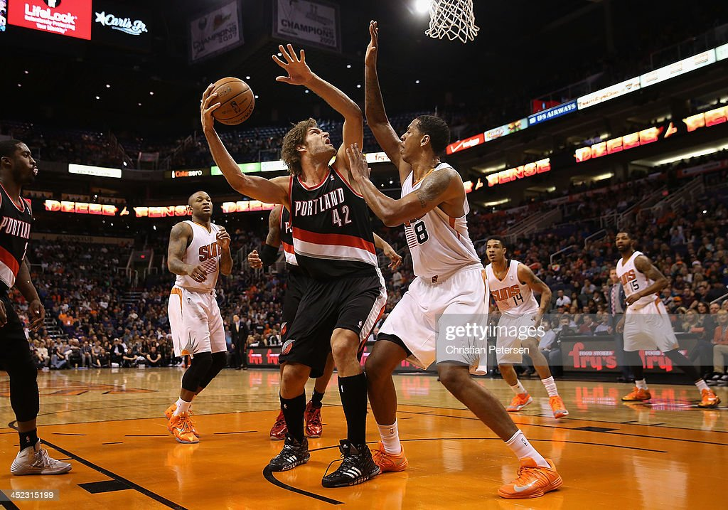 Robin Lopez #42 of the Portland Trail Blazers looks to shoot guarded by Channing Frye #8 of the Phoenix Suns during the first half of the NBA game at US Airways Center on November 27, 2013 in Phoenix, Arizona. The Suns defeated the Trail Blazers 120-106.