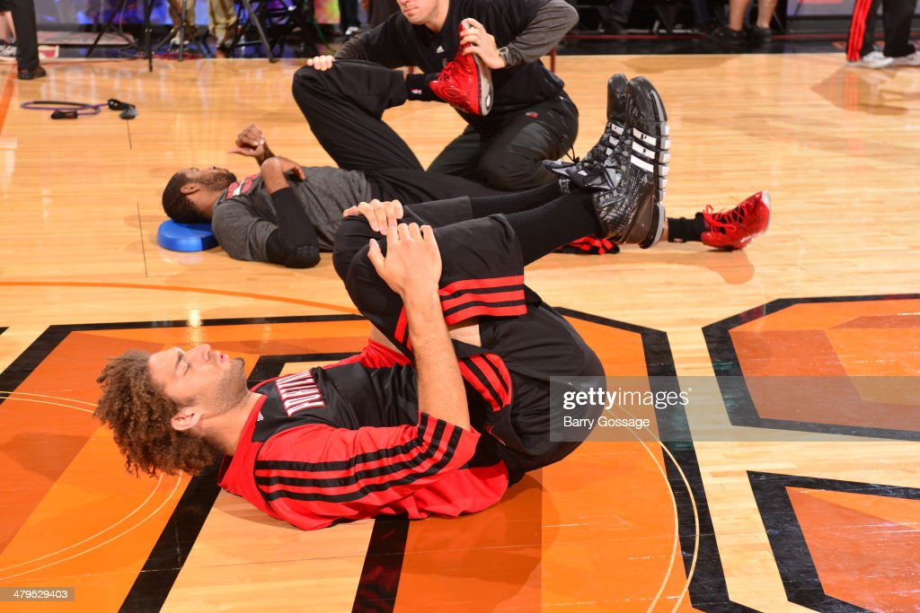 <a gi-track='captionPersonalityLinkClicked' href=/galleries/search?phrase=Robin+Lopez&family=editorial&specificpeople=2351509 ng-click='$event.stopPropagation()'>Robin Lopez</a> #42 of the Portland Trail Blazers prepares before the game against the Phoenix Suns on November 27, 2013 at U.S. Airways Center in Phoenix, Arizona.