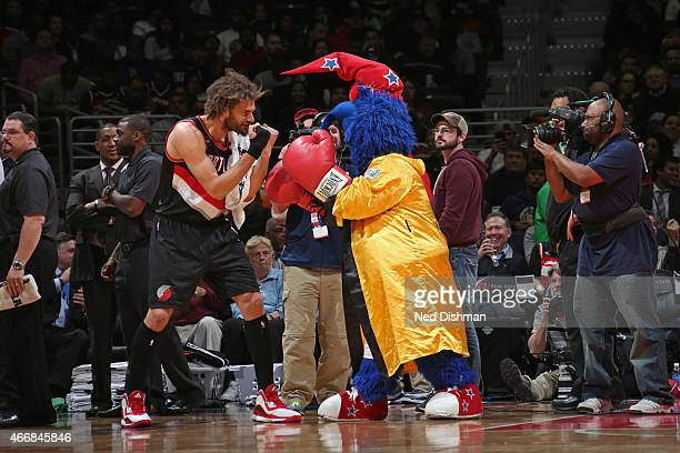 Robin Lopez of the Portland Trail Blazers pretends to box mascot GWiz of the Washington Wizards on March 16 2015 at the Verizon Center in Washington...