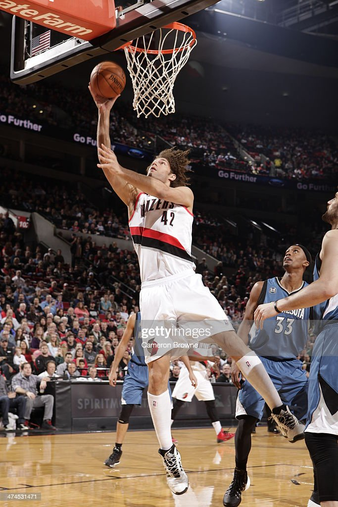 Robin Lopez #42 of the Portland Trail Blazers puts up a layup during a game against the Minnesota Timberwolves on February 23, 2014 at the Moda Center Arena in Portland, Oregon.