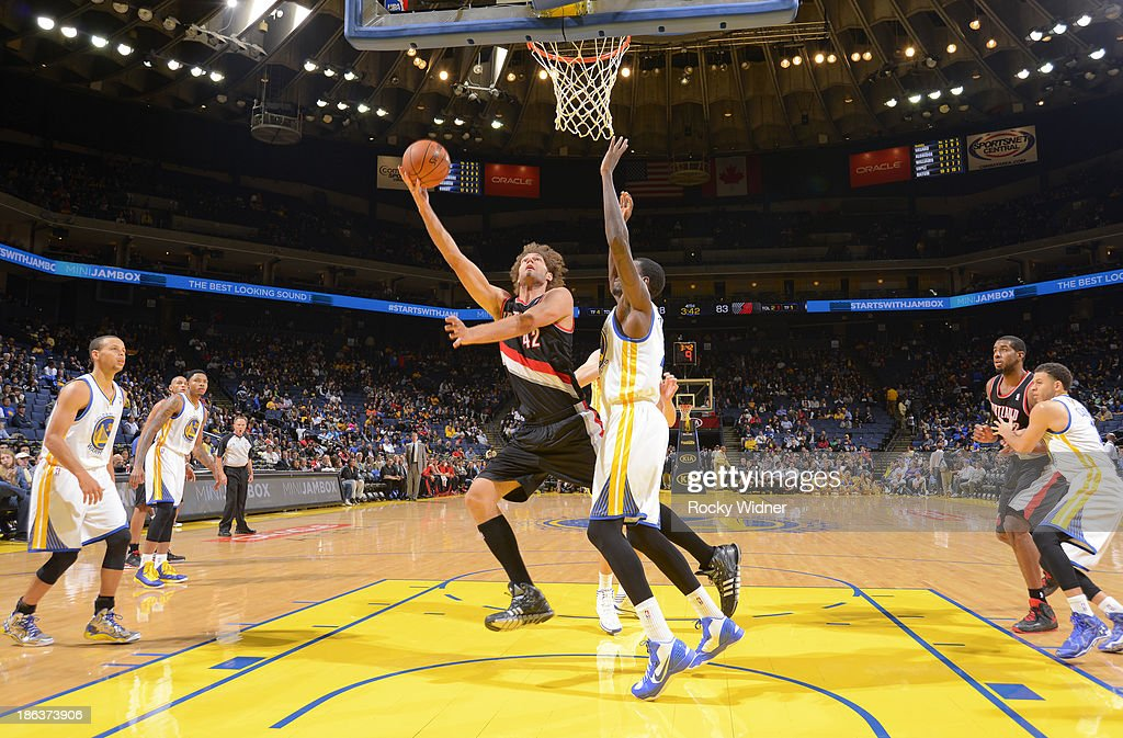 <a gi-track='captionPersonalityLinkClicked' href=/galleries/search?phrase=Robin+Lopez&family=editorial&specificpeople=2351509 ng-click='$event.stopPropagation()'>Robin Lopez</a> #42 of the Portland Trail Blazers shoots against Dewayne Dedmon #21 of the Golden State Warriors on October 24, 2013 at Oracle Arena in Oakland, California.