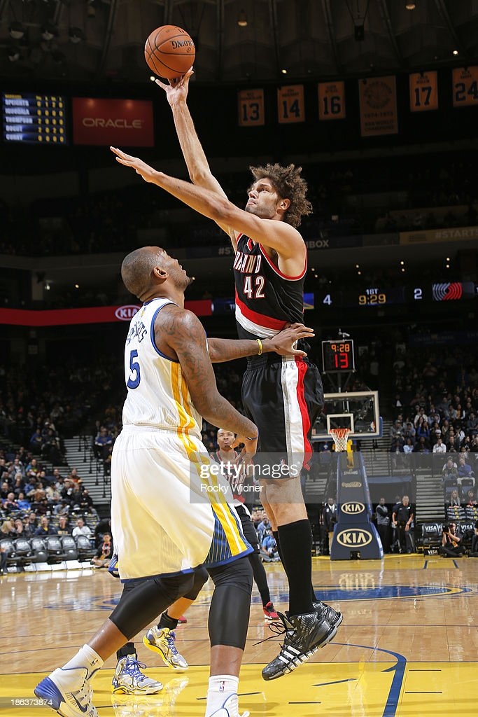<a gi-track='captionPersonalityLinkClicked' href=/galleries/search?phrase=Robin+Lopez&family=editorial&specificpeople=2351509 ng-click='$event.stopPropagation()'>Robin Lopez</a> #42 of the Portland Trail Blazers shoots against <a gi-track='captionPersonalityLinkClicked' href=/galleries/search?phrase=Marreese+Speights&family=editorial&specificpeople=4187263 ng-click='$event.stopPropagation()'>Marreese Speights</a> #5 of the Golden State Warriors on October 24, 2013 at Oracle Arena in Oakland, California.