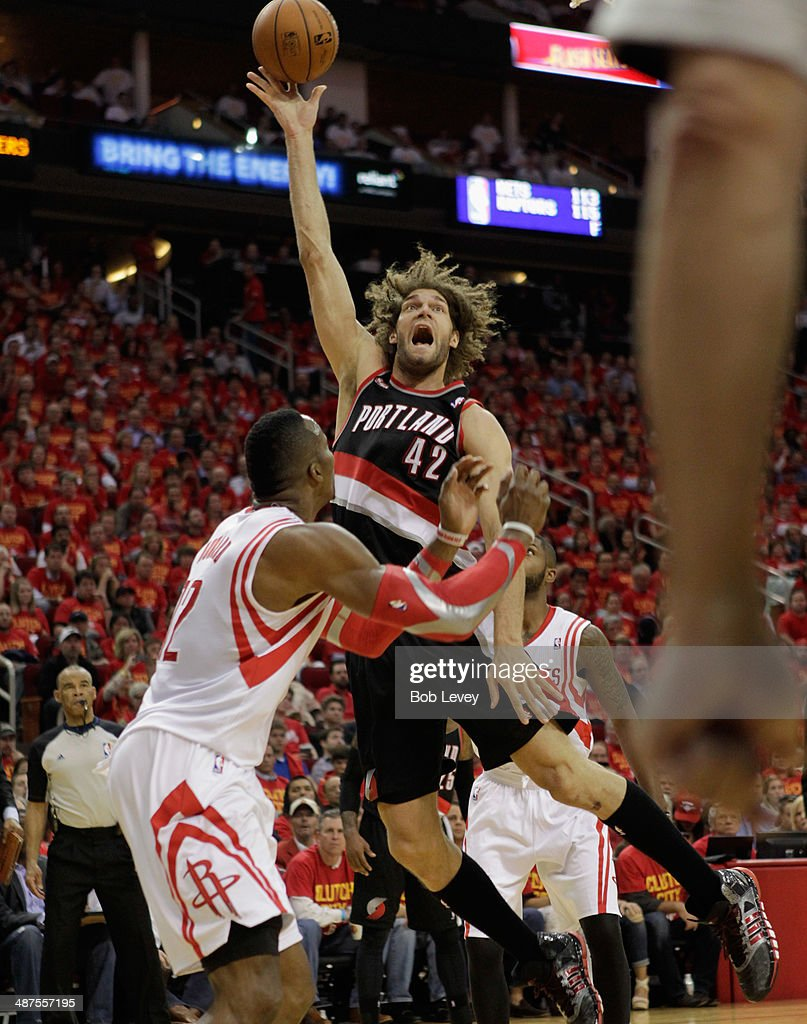 Robin Lopez of the Portland Trail Blazers shoots over Dwight Howard of the Houston Rockets in Game 5 of the Western Conference Quarterfinals during...