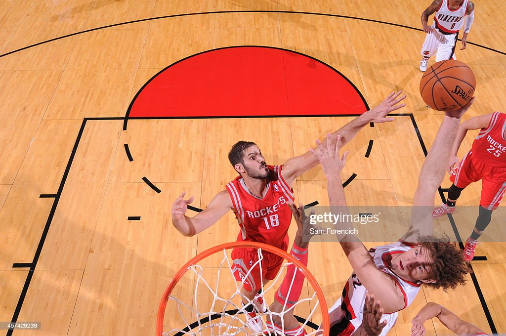 <a gi-track='captionPersonalityLinkClicked' href=/galleries/search?phrase=Robin+Lopez&family=editorial&specificpeople=2351509 ng-click='$event.stopPropagation()'>Robin Lopez</a> #42 of the Portland Trail Blazers shoots the ball against <a gi-track='captionPersonalityLinkClicked' href=/galleries/search?phrase=Omri+Casspi&family=editorial&specificpeople=2298404 ng-click='$event.stopPropagation()'>Omri Casspi</a> #18 of the Houston Rockets on November 5, 2013 at the Moda Center Arena in Portland, Oregon.