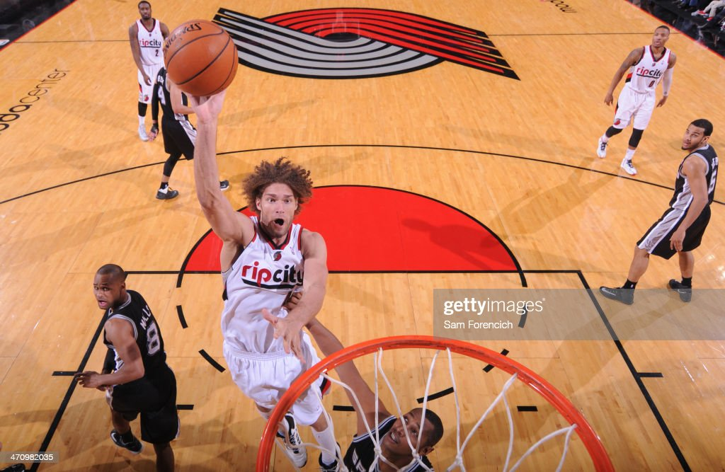 Robin Lopez #42 of the Portland Trail Blazers shoots the ball against the San Antonio Spurs on February 19, 2014 at the Moda Center Arena in Portland, Oregon.
