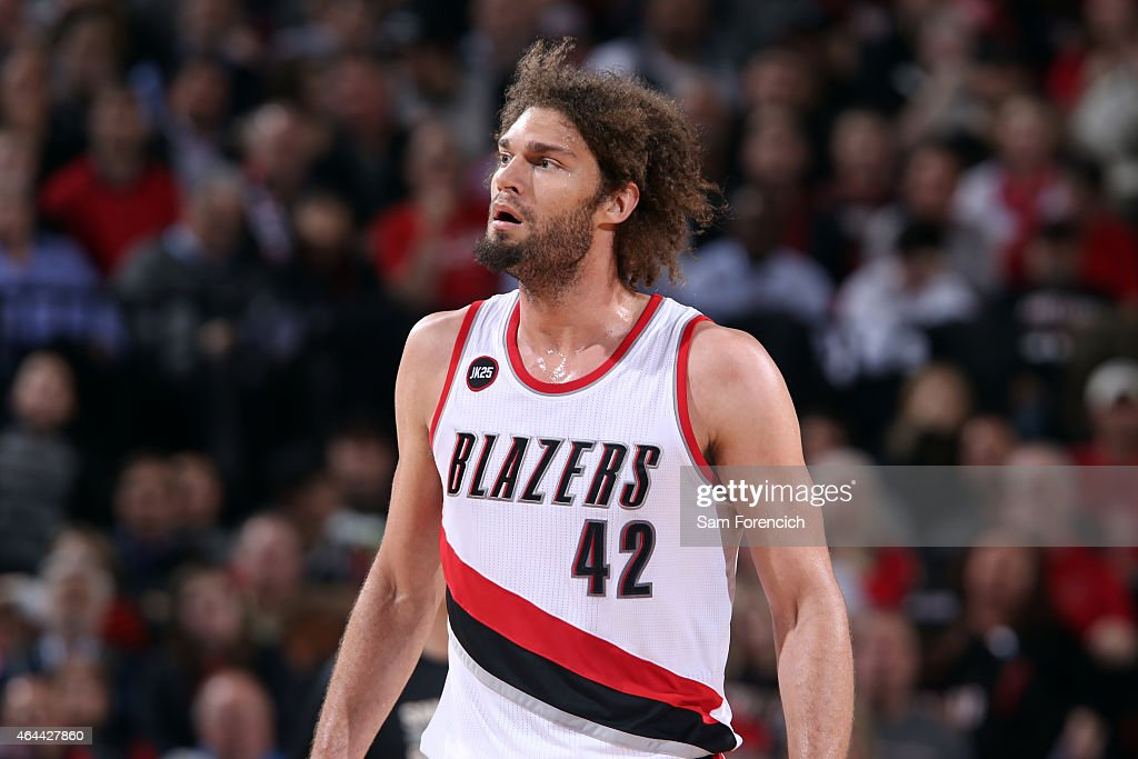 Robin Lopez of the Portland Trail Blazers stands on the court during a game against the San Antonio Spurs on February 25 2015 at the Moda Center in...