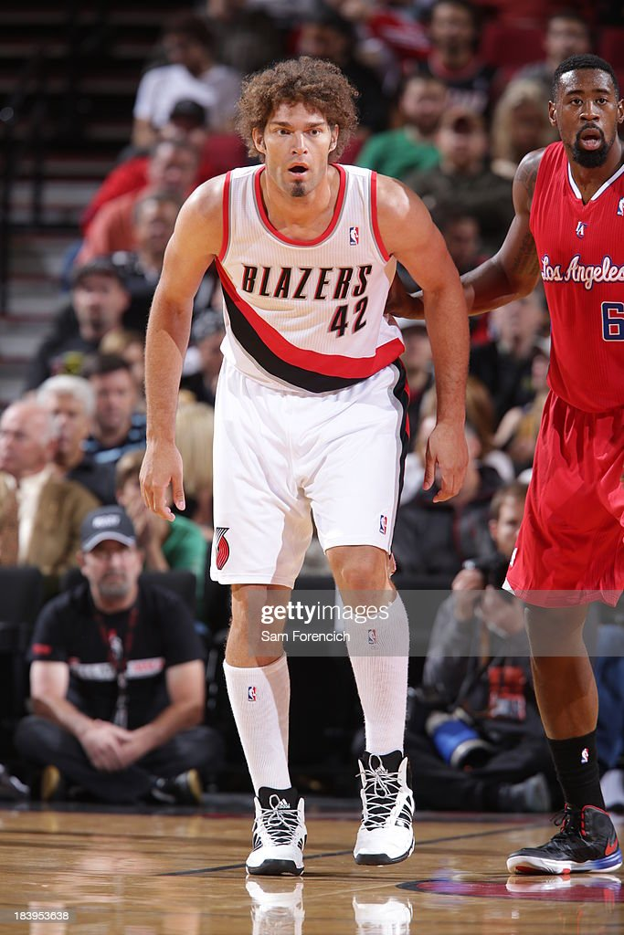<a gi-track='captionPersonalityLinkClicked' href=/galleries/search?phrase=Robin+Lopez&family=editorial&specificpeople=2351509 ng-click='$event.stopPropagation()'>Robin Lopez</a> #42 of the Portland Trail Blazers walks up court against the Los Angeles Clippers on October 7, 2013 at the Moda Center Arena in Portland, Oregon.