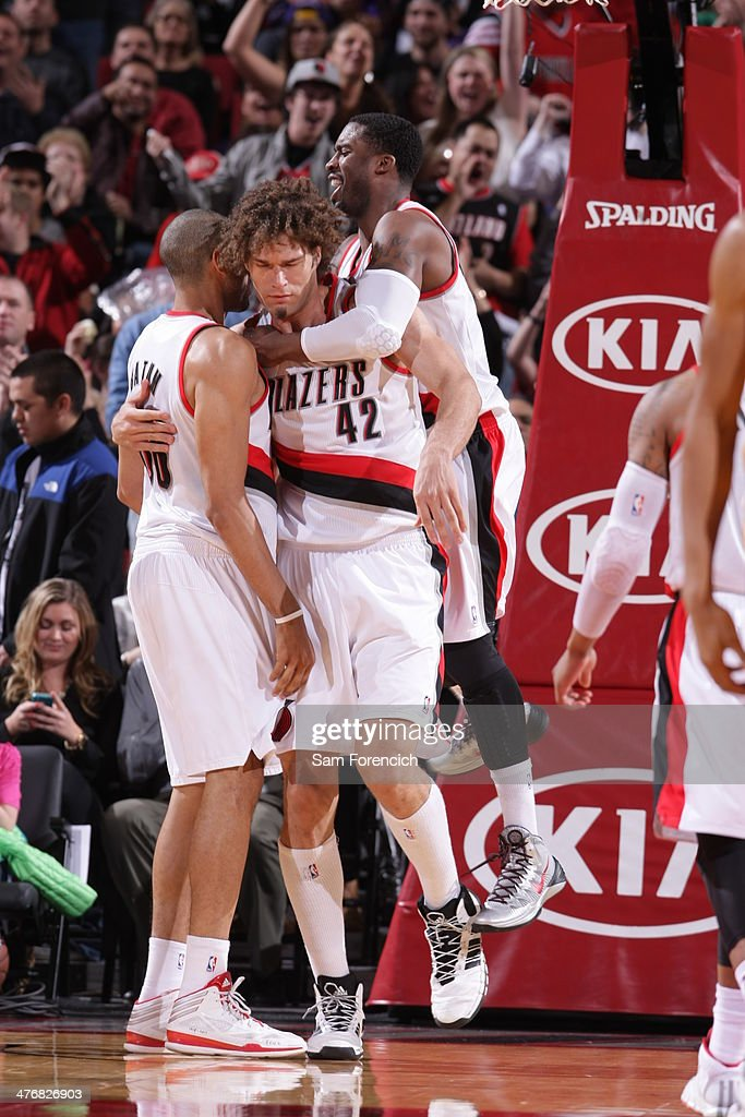 <a gi-track='captionPersonalityLinkClicked' href=/galleries/search?phrase=Robin+Lopez&family=editorial&specificpeople=2351509 ng-click='$event.stopPropagation()'>Robin Lopez</a> #42, <a gi-track='captionPersonalityLinkClicked' href=/galleries/search?phrase=Wesley+Matthews+-+Basketball+Player&family=editorial&specificpeople=804816 ng-click='$event.stopPropagation()'>Wesley Matthews</a> #2 and <a gi-track='captionPersonalityLinkClicked' href=/galleries/search?phrase=Nicolas+Batum&family=editorial&specificpeople=3746275 ng-click='$event.stopPropagation()'>Nicolas Batum</a> #88 of the Portland Trail Blazers celebrate against the Los Angeles Lakers on March 3, 2014 at the Moda Center Arena in Portland, Oregon.