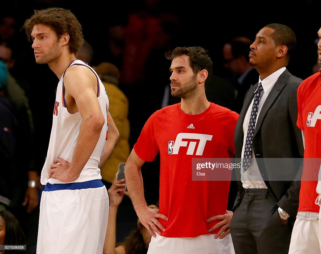 Robin LopezJose Calderon and Carmelo Anthony of the New York Knicks look on from the bench as the Oklahoma City Thunder win in overtime at Madison...