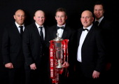 Robin McBryde Neil Jenkins Rob Howley Shaun Edwards and Mark Jones of Wales pose with the Six Nations trophy following his team's victory during the...