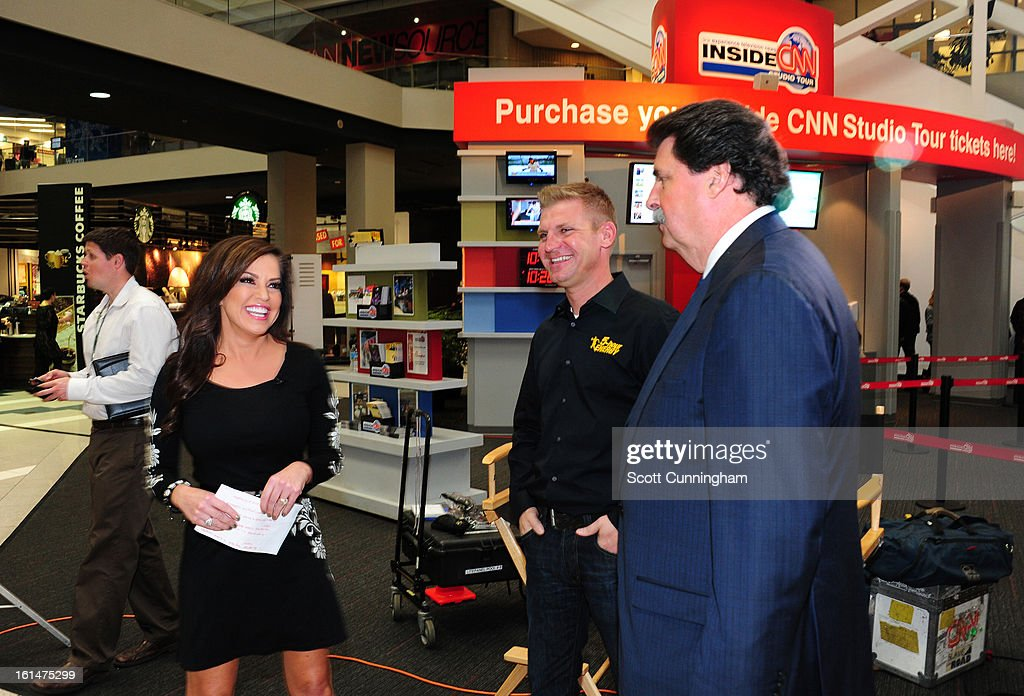 Robin Meade of CNN Headline News greets <a gi-track='captionPersonalityLinkClicked' href=/galleries/search?phrase=Clint+Bowyer&family=editorial&specificpeople=537951 ng-click='$event.stopPropagation()'>Clint Bowyer</a>, driver of the #15 5-hour Energy Toyota, and NASCAR President <a gi-track='captionPersonalityLinkClicked' href=/galleries/search?phrase=Mike+Helton+-+Racing+Executive&family=editorial&specificpeople=226522 ng-click='$event.stopPropagation()'>Mike Helton</a> during the Road to Daytona Fueled By Sunoco Tour at CNN Center on February 11, 2013 in Atlanta, Georgia.