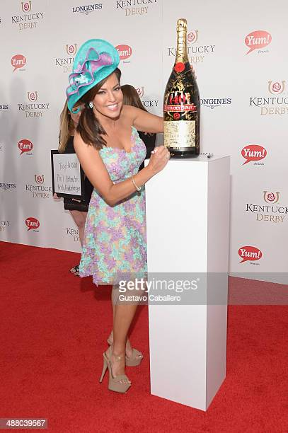 Robin Meade toasts with Moet Chandon at the 140th Kentucky Derby at Churchill Downs on May 3 2014 in Louisville Kentucky