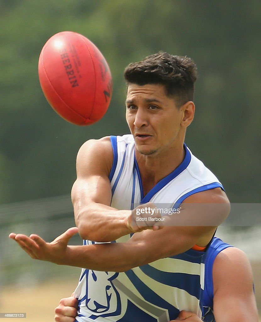Robin Nahas passes the ball during a North Melbourne Kangaroos AFL training session at Aegis Park on February 12, 2014 in Melbourne, Australia.