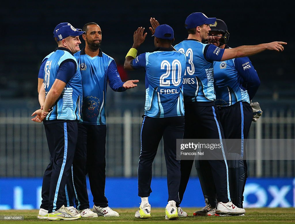 Robin Peterson of Leo Lions celebrates the wicket of Imran Farhat of Sagittarius Strikers with his team-mates during the Oxigen Masters Champions League match between Leo Lions and Sagittarius Strikers on February 6, 2016 in Sharjah, United Arab Emirates.