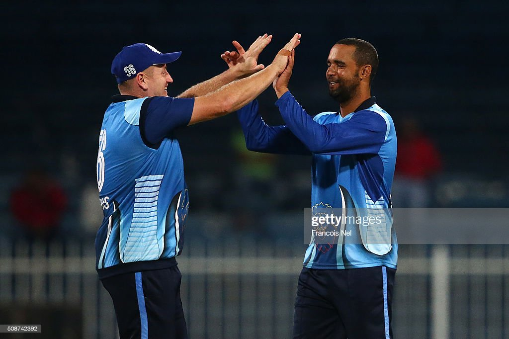 <a gi-track='captionPersonalityLinkClicked' href=/galleries/search?phrase=Robin+Peterson&family=editorial&specificpeople=843359 ng-click='$event.stopPropagation()'>Robin Peterson</a> of Leo Lions celebrates the wicket of Imran Farhat of Sagittarius Strikers with his team-mate <a gi-track='captionPersonalityLinkClicked' href=/galleries/search?phrase=Scott+Styris&family=editorial&specificpeople=216551 ng-click='$event.stopPropagation()'>Scott Styris</a> (L) during the Oxigen Masters Champions League match between Leo Lions and Sagittarius Strikers on February 6, 2016 in Sharjah, United Arab Emirates.