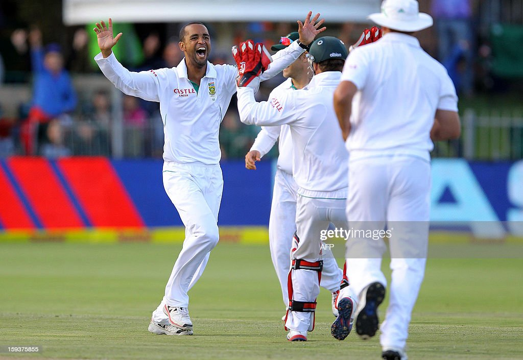 Robin Peterson of South Africa celebrates on January 12, 2013 the wicket of New Zealand's Brednon McCullum on the second day of the second and final Test between South Africa and New Zealand at St George's Park in Port Elizabeth. AFP PHOTO / Anesh Debiky