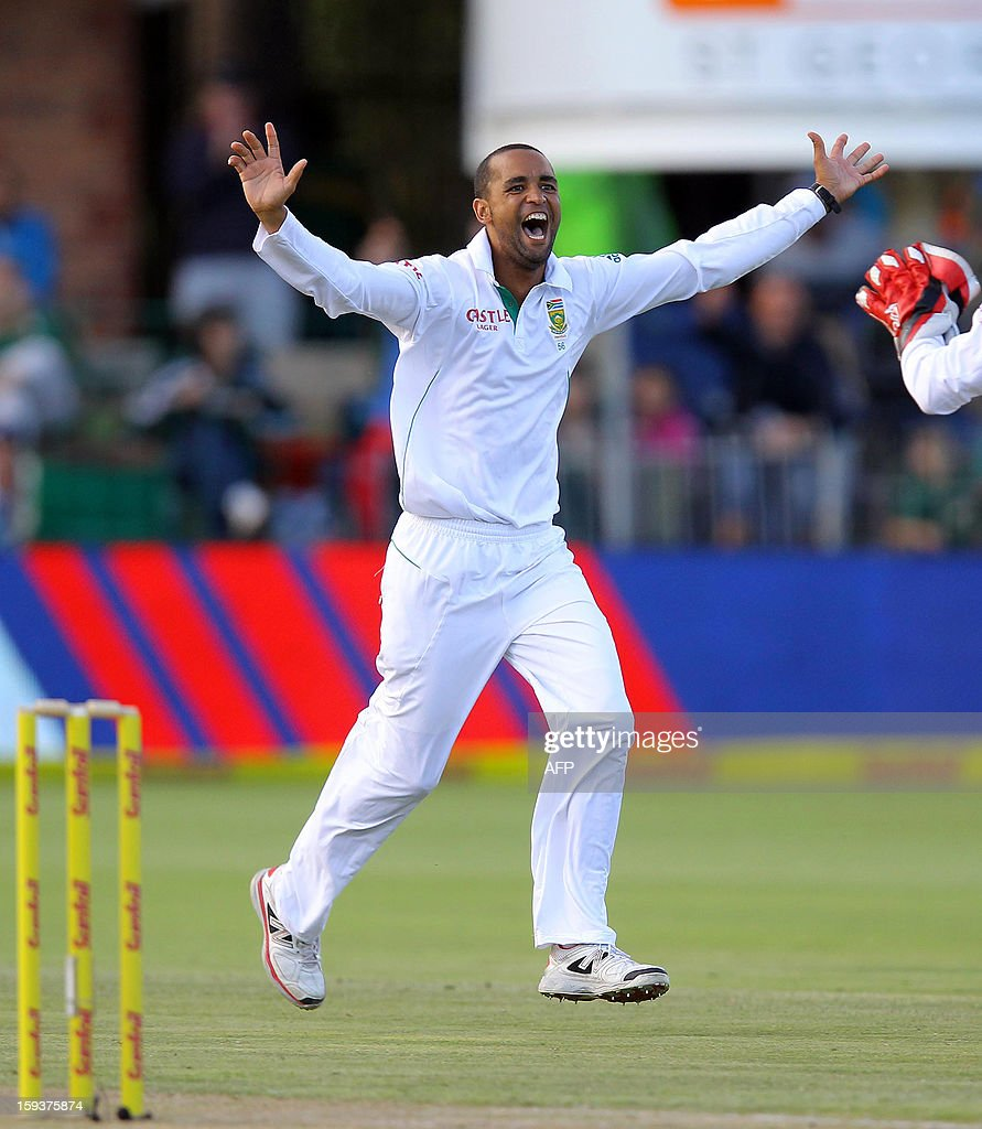 Robin Peterson of South Africa celebrates on January 12,2013 the wicket of New Zealand's Brednon McCullum on the second day of the second and final Test between South Africa and New Zealand at St George's Park in Port Elizabeth. AFP PHOTO / Anesh Debiky