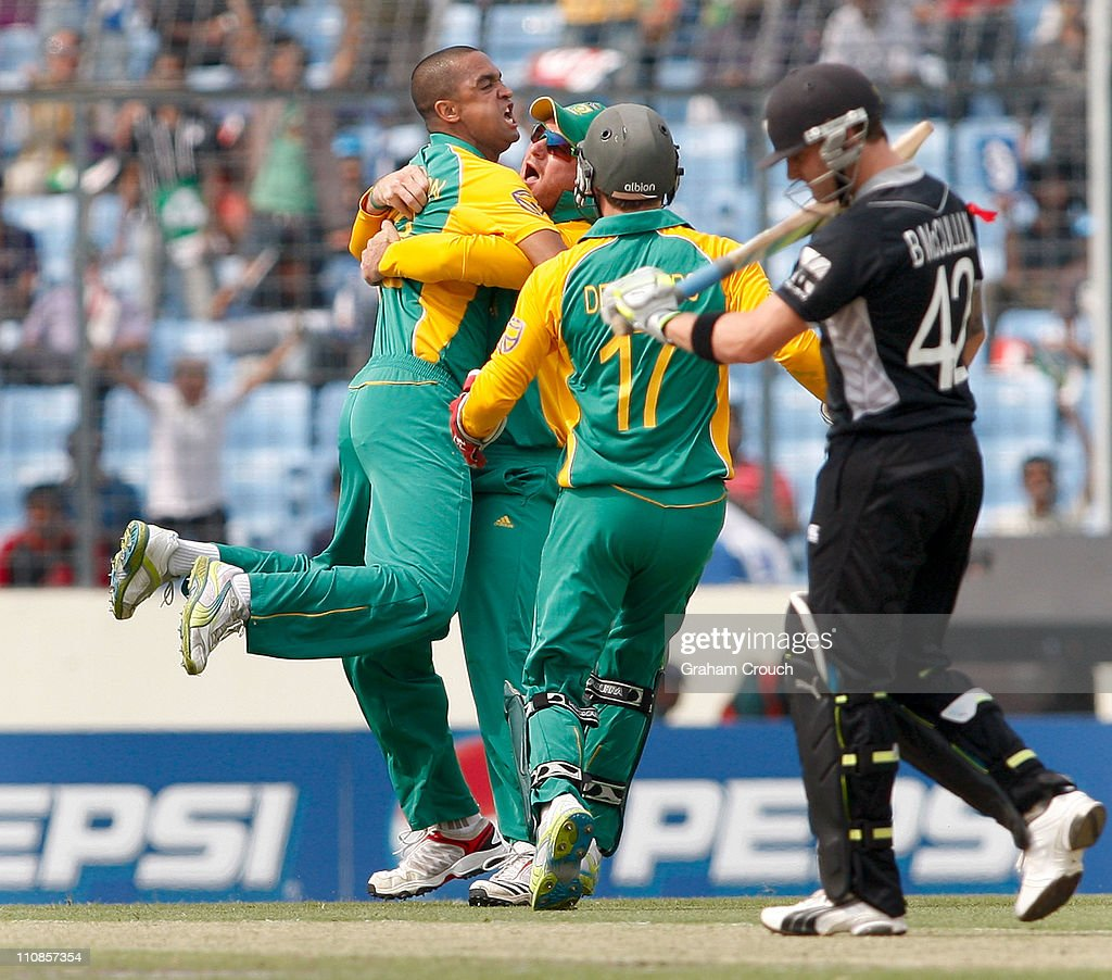 <a gi-track='captionPersonalityLinkClicked' href=/galleries/search?phrase=Robin+Peterson&family=editorial&specificpeople=843359 ng-click='$event.stopPropagation()'>Robin Peterson</a> of South Africa celebrates with <a gi-track='captionPersonalityLinkClicked' href=/galleries/search?phrase=Graeme+Smith&family=editorial&specificpeople=193816 ng-click='$event.stopPropagation()'>Graeme Smith</a> after Peterson caught and bowled Brendon McCullum of New Zealand during 2011 ICC World Cup Quarter-Final match between New Zealand and South Africa at Shere-e-Bangla National Stadium on March 25, 2011 in Dhaka, Bangladesh.