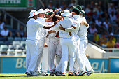 Robin Peterson of South Africa is congratulated by team mates after dismissing Michael Clarke of Australia during day four of the Third Test Match...