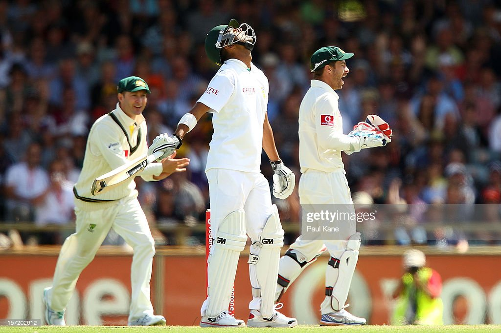 Robin Peterson of South Africa reacts to being dismissed as Michael Clarke and Matthew Wade of Australia celebrate the wicket during day one of the Third Test Match between Australia and South Africa at WACA on November 30, 2012 in Perth, Australia.