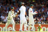 Robin Peterson of South Africa reacts to being dismissed as Michael Clarke and Matthew Wade of Australia celebrate the wicket during day one of the...