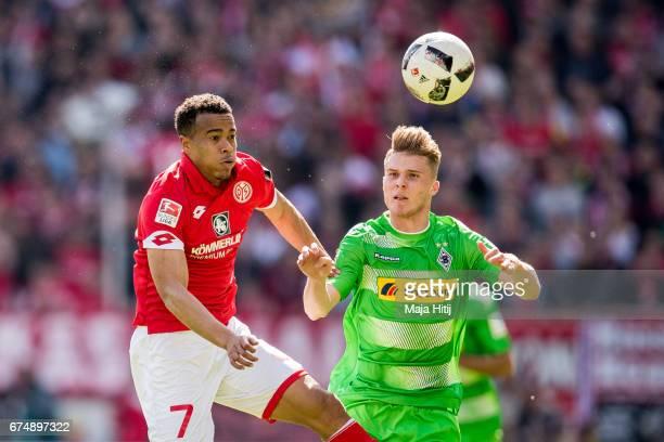 Robin Quaison of Mainz and Nico Elvedi of Moenchengladbach battle for the ball during the Bundesliga match between 1 FSV Mainz 05 and Borussia...