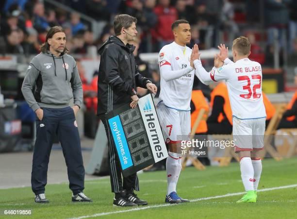 Robin Quaison of Mainz shakes hands with Pablo de Blasis of Mainz during the Bundesliga match between Bayer 04 Leverkusen and 1 FSV Mainz 05 at...