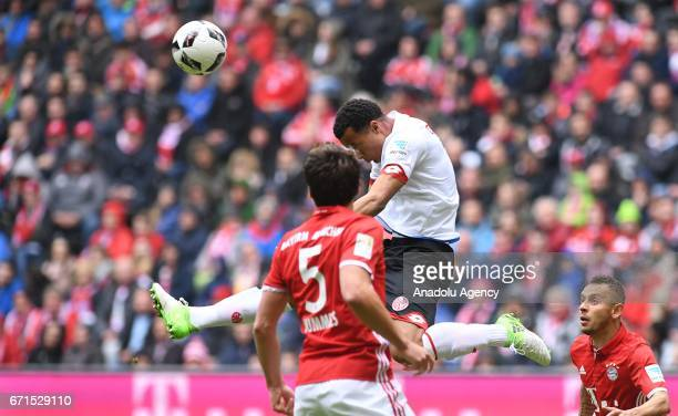 Robin Quaison of Munich and Mats Hummels of Mainz vie for the ball during the Bundesliga soccer match between FC Bayern Munich and Mainz 05 at the...