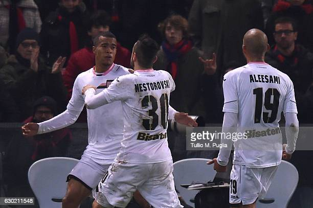 Robin Quaison of Palermo celebrates after scoring the equalizing goal during the Serie A match between Genoa CFC and US Citta di Palermo at Stadio...