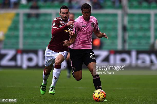 Robin Quaison of Palermo is challenged by Davide Zappacosta of Torino during the Serie A match between US Citta di Palermo and Torino FC at Stadio...