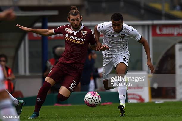 Robin Quaison of Palermo is challenged by Gaston Silva during the Serie A match between Torino FC and US Citta di Palermo at Stadio Olimpico di...