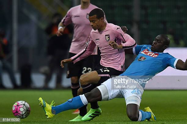 Robin Quaison of Palermo is challenged by Kalidou Koulobaly during the Serie A match between US Citta di Palermo and SSC Napoli at Stadio Renzo...