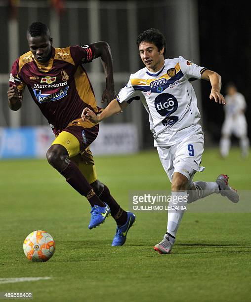 Robin Ramirez of Colombia's Deportes Tolima vies for the ball with Oscar Ayala of Paraguay's Sportivo Luqueno during their 2015 Sudamericana Cup...