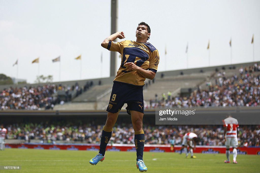 Robin Ramirez of Pumas celebrates score a goal against Jaguares during the match as part of the Clausura 2013 Liga MX at Olimpico Stadium on April 28, 2013 in Mexico City, Mexico.