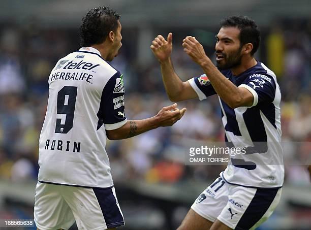 Robin Ramirez of Pumas celebrates with Jehu Chiapas the first goal gainst America during their Mexican Clausura Tournament quarterfinal football...