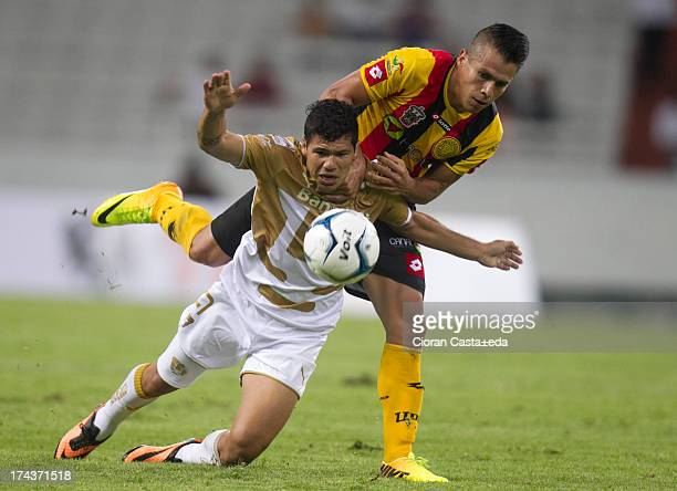 Robin Ramirez of Pumas competes for the ball with Marcelo Alatorre of Leones Negros during a match between Leones Negros and Pumas as part of the Cup...